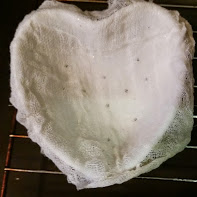 Lining the mold with cheesecloth makes it easy to unmold later.